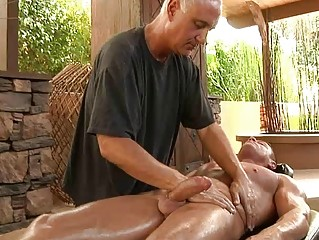 muscled gay hunk obtains his penis oiled and