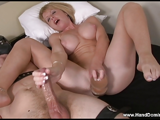 woman pleases herself  during  giving a femdom