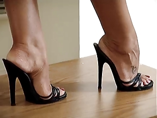 latina foot and legs into high shoes