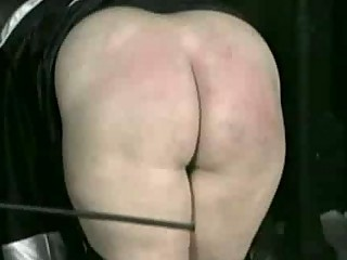 bend over nun is spanked on her anal and hands