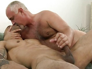 awesome tattooed gay giving handjob to his mature