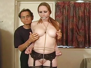 slave hogtied into her bikini