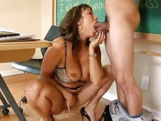 filthy brunette with gigantic puppies licks