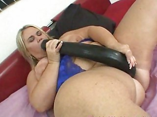 fat girl pleasing with a giant device