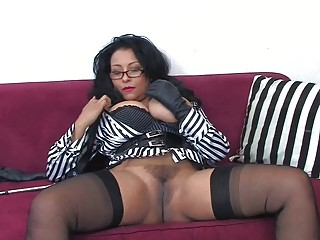 brunette lady with big muffins and glasses does