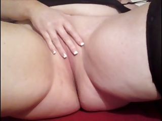 plump lady on bedstead pleasing with herself