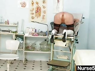 pale old doctor self exam with cave spreader