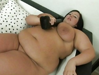 big brown haired momma with huge bosoms uses her