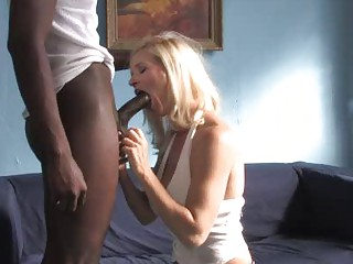 horny blond lady driving a large ebony penis