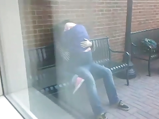 students humping on a bench inside outdoor
